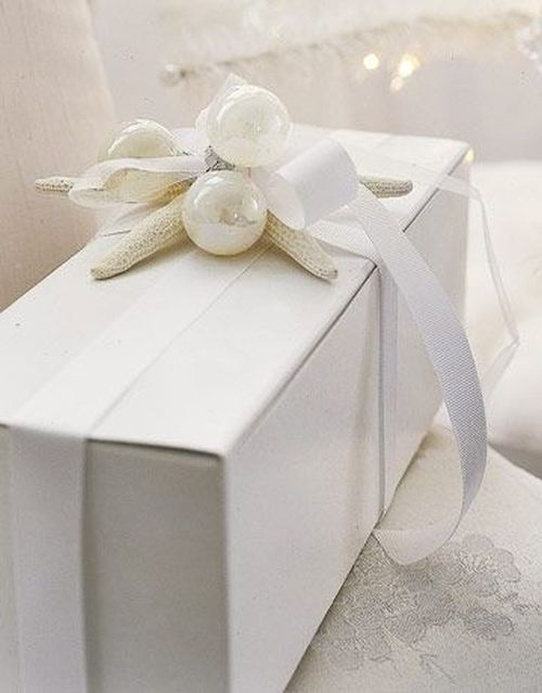 pretty white Christmas gift wrapping
